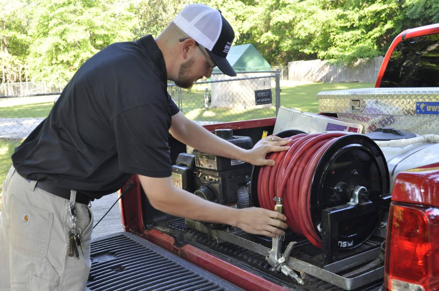 Bug House Warner Robbins employee working on pest control