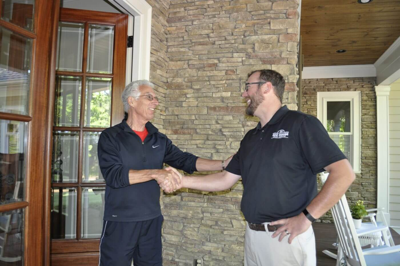 Bug House Lake Oconee pest control employee shaking hands with client