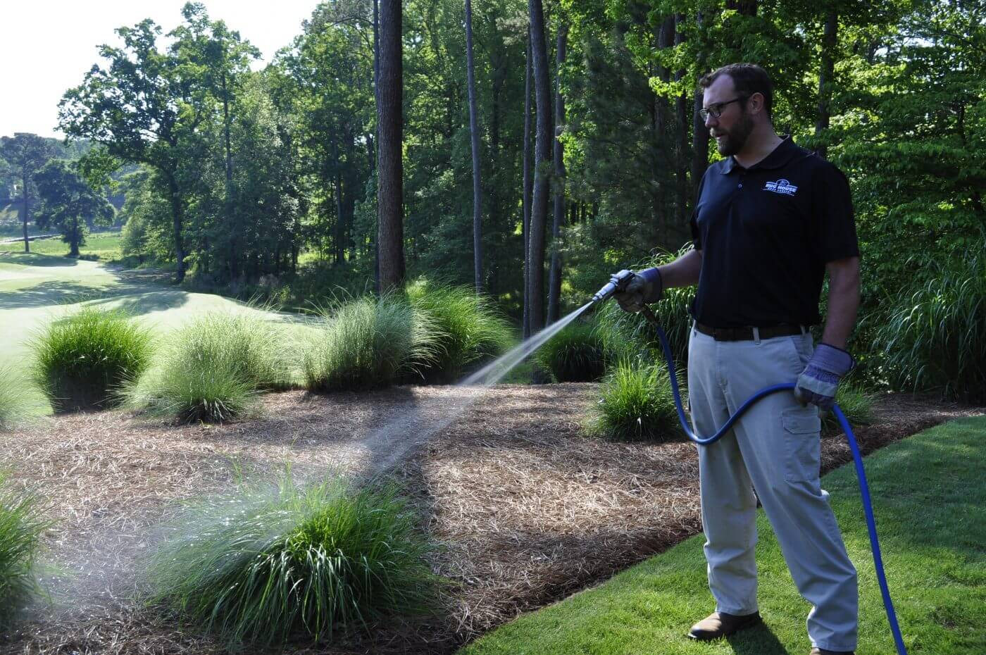 Bug House Lake Oconee employee watering lawn