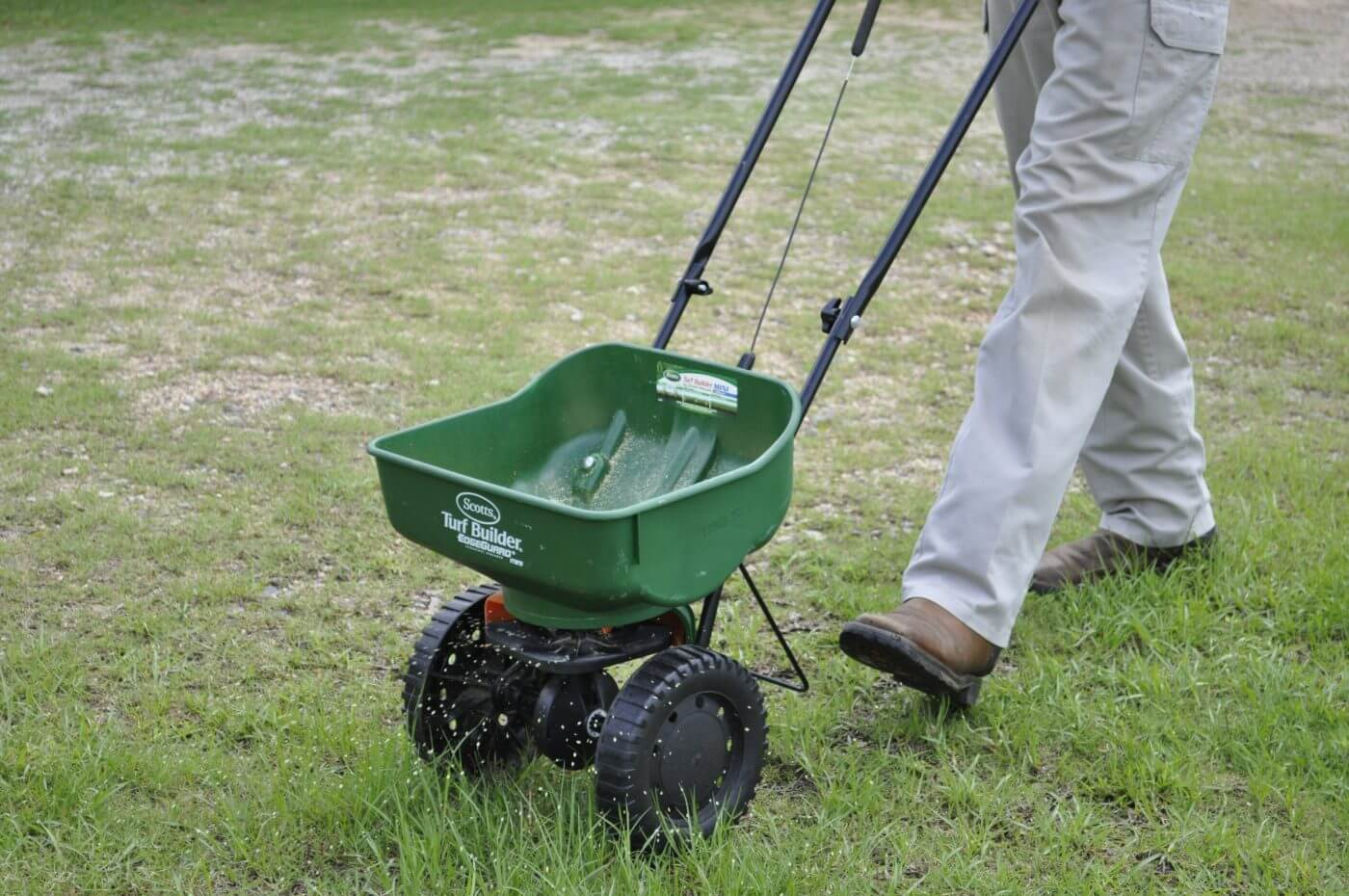 Bug House Monroe pest control employee seeding grass